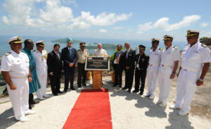 File image of Modi unveiling a plaque to mark the opening of the Coastal Surveillance Radar station at Mahe. Other dignitaries, including five naval officers in uniform stand on his either side. Sea and islands in the background